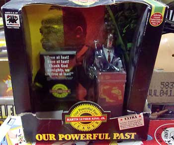 The Dr. Martin Luther King Jr. doll by Olmec. It was produced in 1992 and sold for $15.99. This one at auction has a price tag of 90 cents.