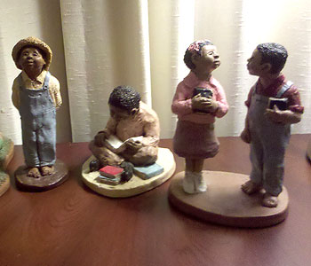 "Figurines from the collection, including ""First Love"" on the right."