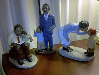 "In the center ""Walking with Grandpa,"" along with other figurines."