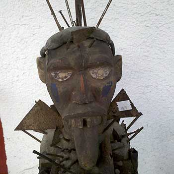 African nail fetish statue