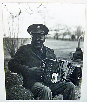 Elderly black accordion player
