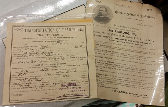 Two documents from the box: A body transport paper (left) and an upcoming training session in 1894 on embalming.