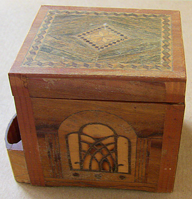 The sweet little wooden mystery box with its inlaid patterns.