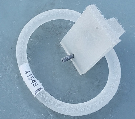 An ice-covered towel holder.