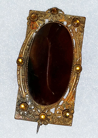 Brooch with large brown stone