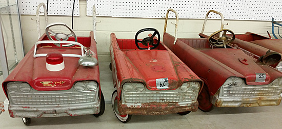 A selection of fire chiefs pedal cars. There were plenty of them, selling for xx to xx.