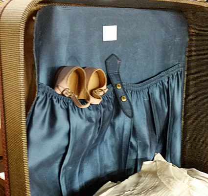suitcase with toddler clothes
