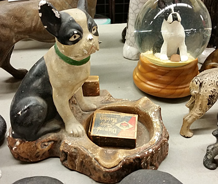 This chalkware Boston Terrier looks like an old one. Even the box of matches apear aged.