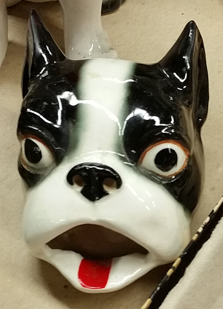 Boston Terrier head, with a dip in the red tongue that apparently held something.