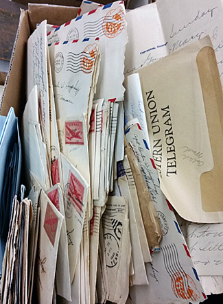 A stack of letters, along with a telegram, at auction.