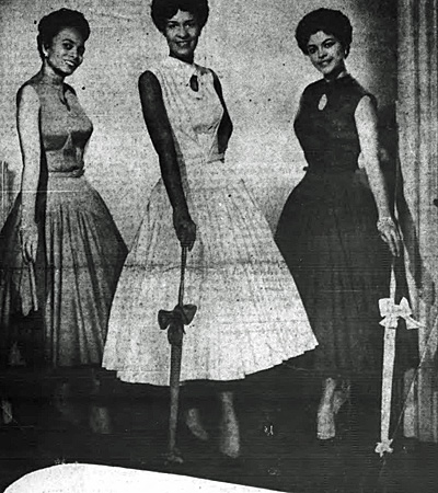 From left to right, models Lois Bell, Muriel French, Vivienne Hampton show off fashions for an upcoming show at the r, get ready for show at Rockland Palace. From the Oct. 24, 1953, New York Age and Defender.