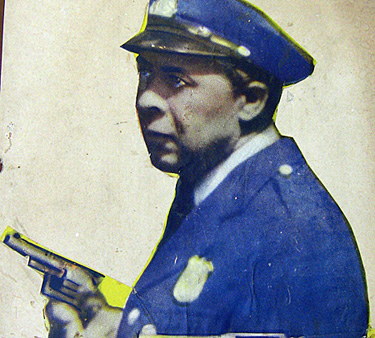 Up-close view of a cut-out presumably from an Oscar Micheaux movie poster.