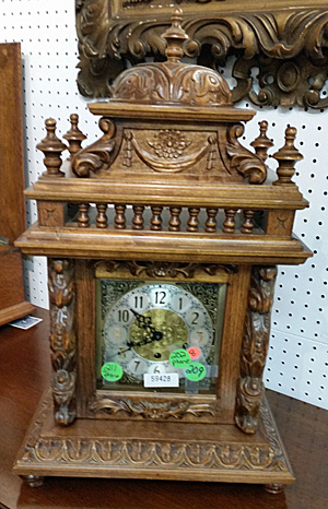 A tabletop clock with intricate designs.
