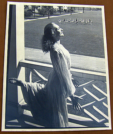 Doris Humphrey strikes a pose on a balcony at Bennington while students mimic her on the lawn, 1940??