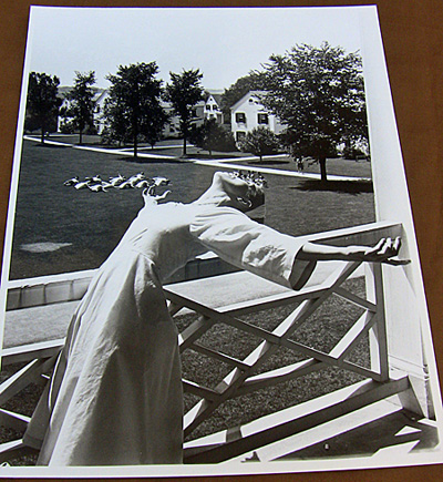 Martha Graham strikes a pose on a balcony at Bennington while students mimic her on the lawn, 1941??