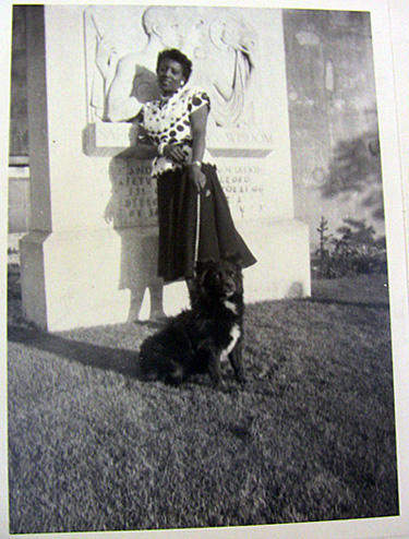An unidentified woman and her dog.