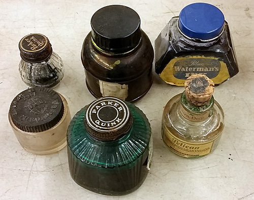 Opened bottles of ink.