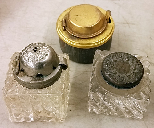 Glass and metal inkwells.