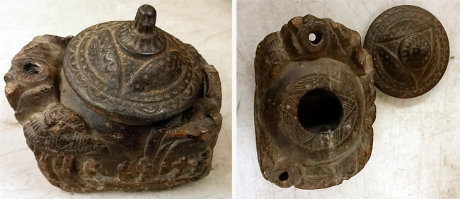 Carved stone inkwell.