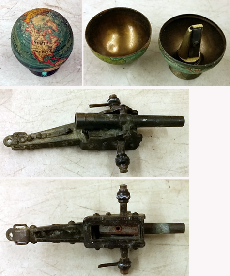 Figurative pencil sharpeners in the shapes of a globe and cannon.