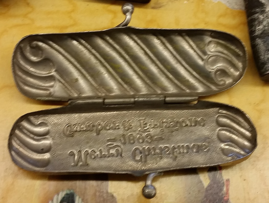 A look inside a match safe given out by the Gruber & Frixione, Christmas 1893. It shows the grooved bottom used for striking a match. Gruber & Frixione was a bar.
