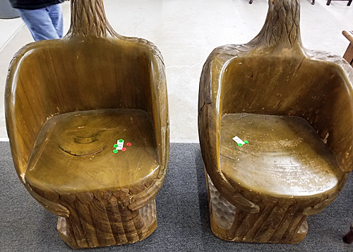 The backside of the giant wooden eagles showed that they were chairs.