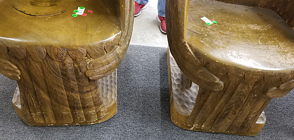The carved tail wings of the wooden eagle chairs.