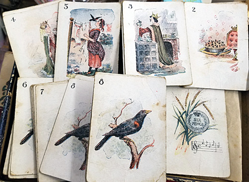 """An array of cards from the """"Four and Twenty Blackbirds"""" card game."""