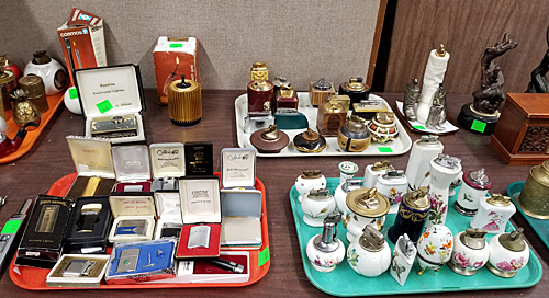 An array of lighters on the auction tables.