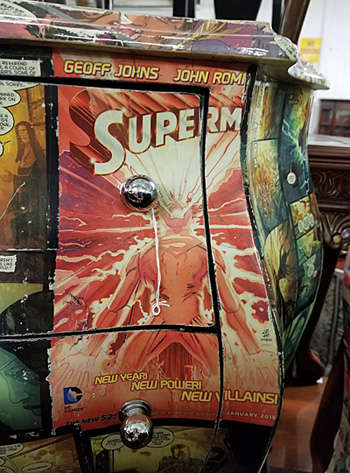 A decoupaged image of the Superman comics on the front of one of the chests.