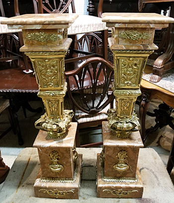 A pair of stands with marble tops and base.