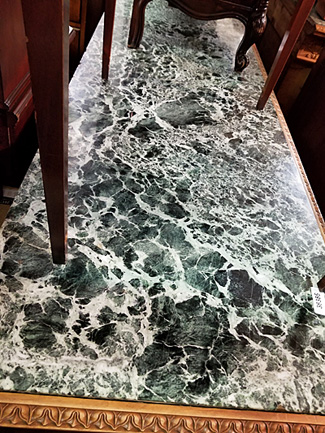 Marble table top with green tones.